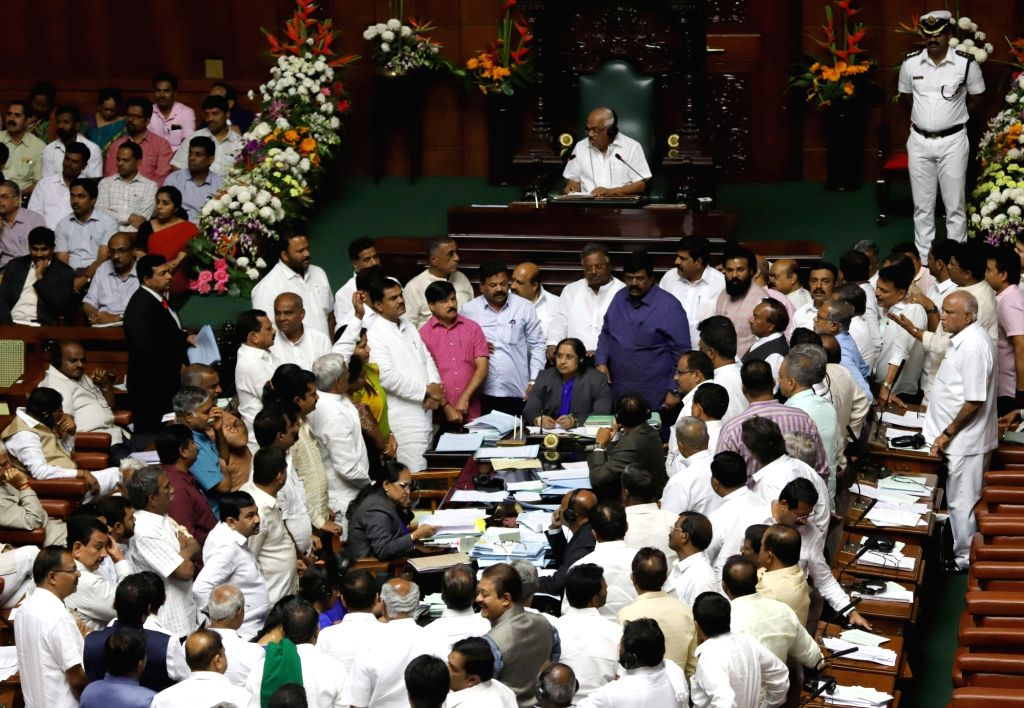 Bengaluru: BJP MLAs stage a protest in Karnataka Assembly during budget session in Bengaluru, on Feb 13, 2019. (Photo: IANS)
