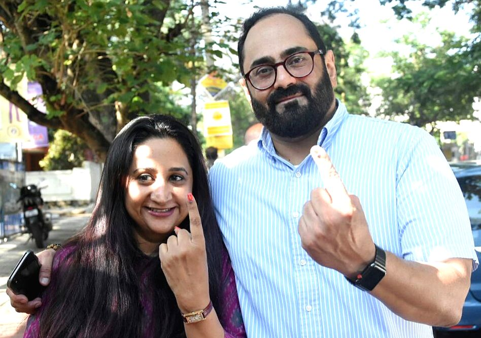 Bengaluru: BJP Rajya Sabha MP Rajeev Chandrasekhar along with his wife Anju Chandrasekhar shows their finger marked with phosphoric ink after casting their vote at a polling booth during Karnataka Assembly Polls at Koramangala Assembly Constituency,