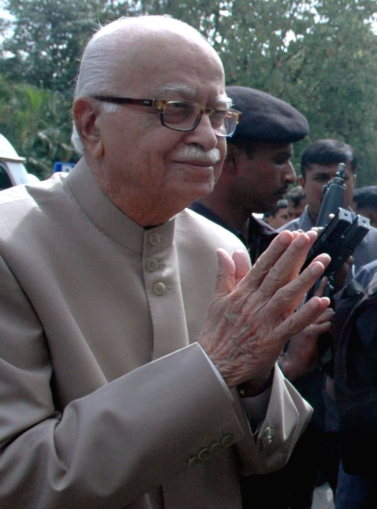 BJP veteran and party MP from Gandhinagar L K Advani arrives in Bengaluru on Nov 30, 2014.