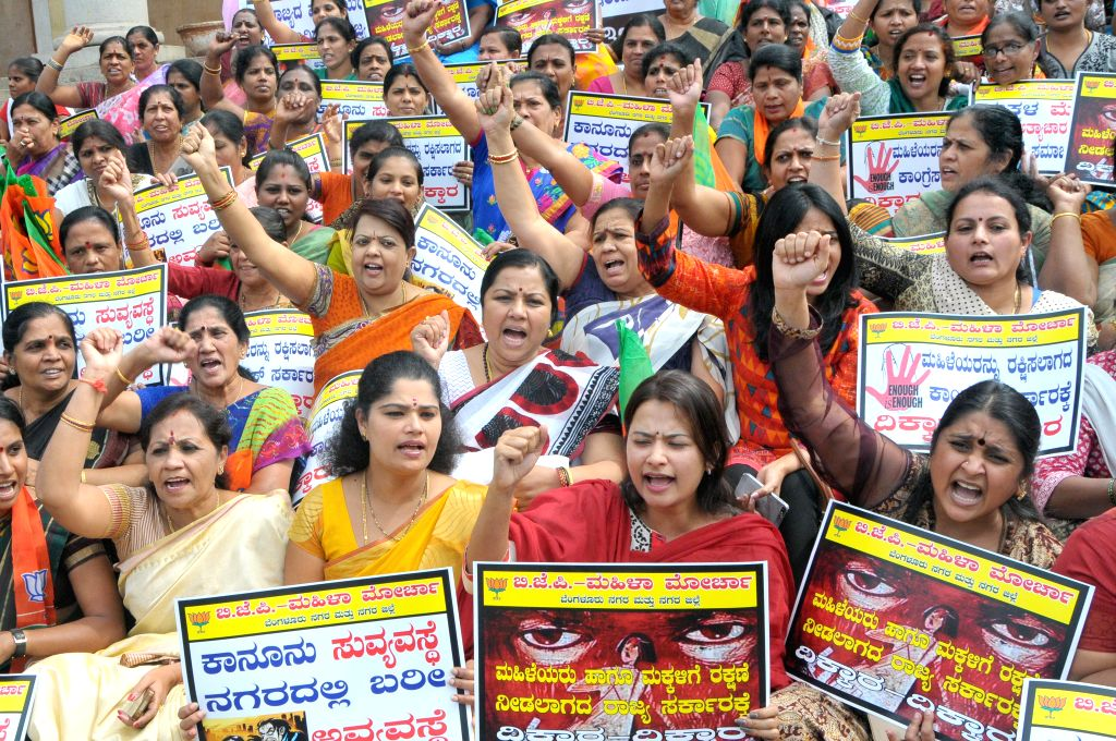 BJP women wing activists stage a demonstration against Karnataka government's failure to curb crime against women in Bengaluru, on Dec 2, 2014.