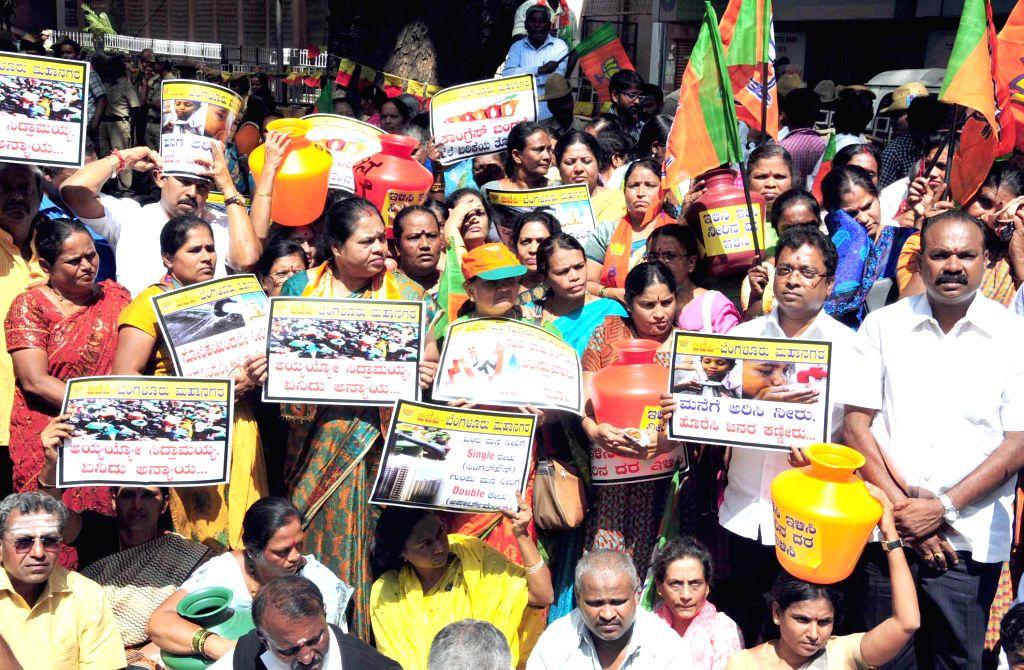 BJP workers stage a demonstration against hike in water tariff in Bengaluru, on Nov 10, 2014.