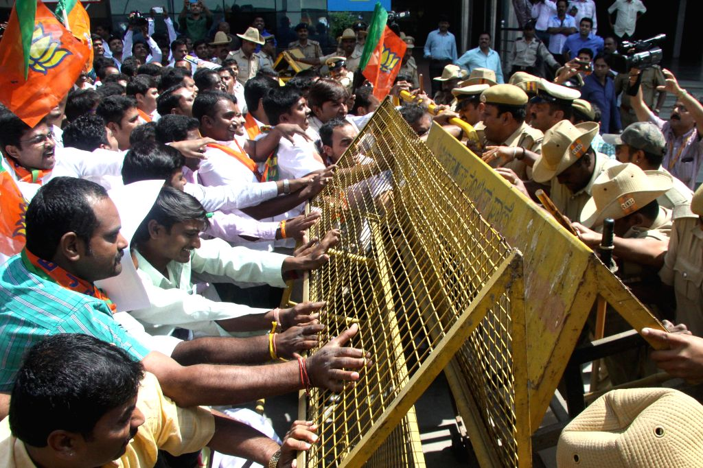 BJYM activists stage a demonstration against hike in BMTC bus fare in Bengaluru, on Nov 6, 2014.