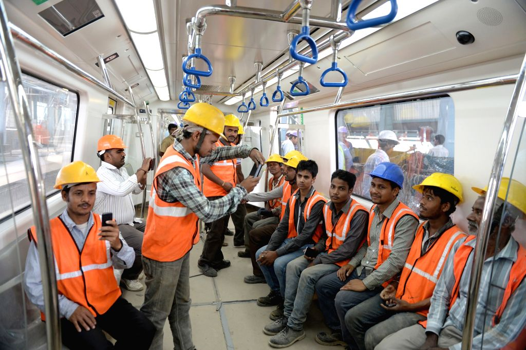 BMRCL staff members  during a trail run of a Bengaluru metro rake between Magadi Road to Mysore Road on March 27, 2015.