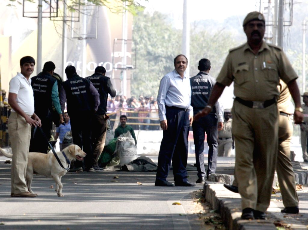 Bengaluru: Bomb squad in action after a suspicious object was found near Cauvery theatre in Bengaluru, on Jan 15, 2016.