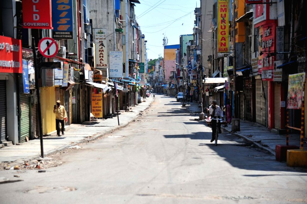 Bengaluru: Busy Chikkapete shopping area wears a deserted look during the nationwide lockdown in the wake of novel coronavirus (COVID 19) pandemic, in Bengaluru on April 14, 2020. (Photo: IANS)