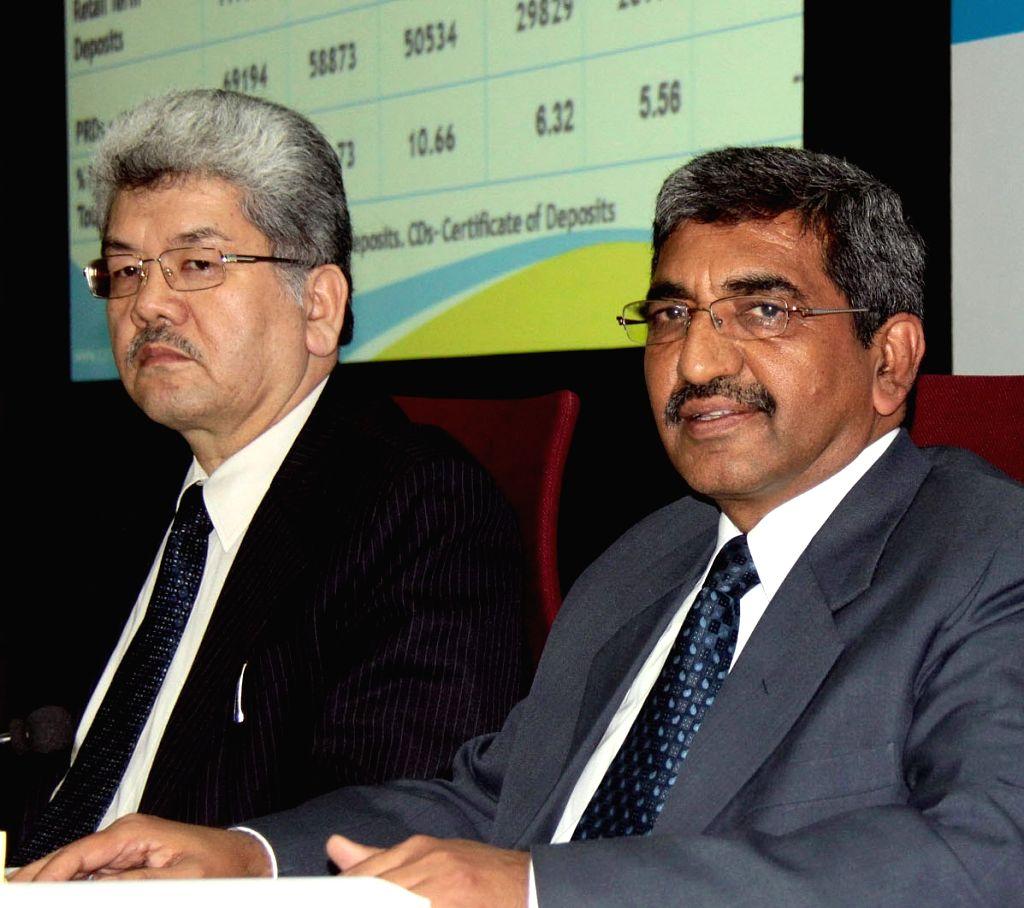 :Bengaluru: Canara Bank MD and CEO Rakesh Sharma (R) addresses a press conference in Bengaluru on Nov. 4, 2015. (Photo: IANS).