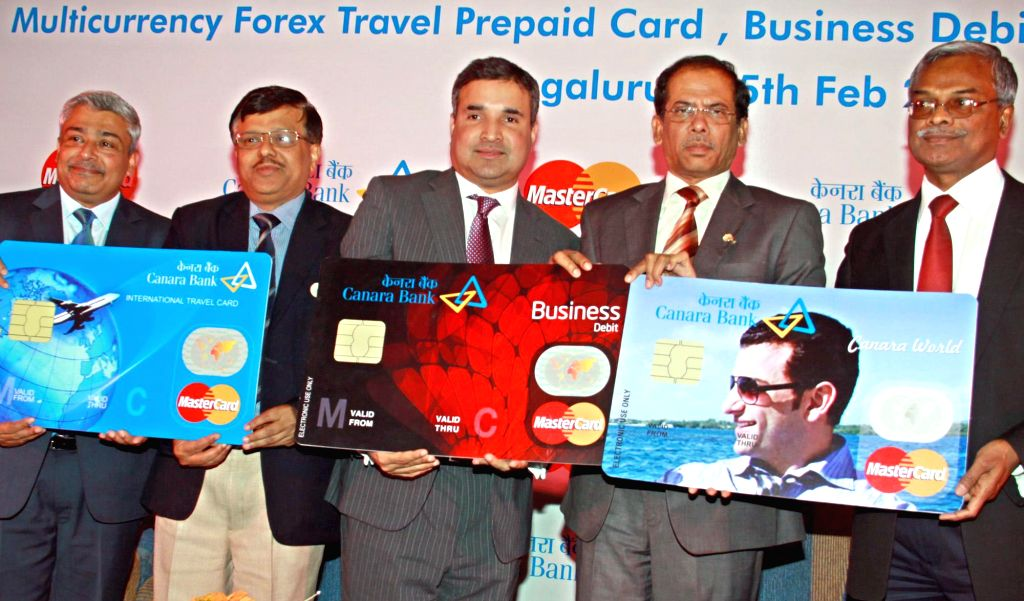 Canara Bank MD and CEO V S Krishna Kumar with Ari Sarker and Vikas Verma of MasterCard during a press conference organised to launch three new cards in Bengaluru on Feb 26, 2015. - Vikas Verma