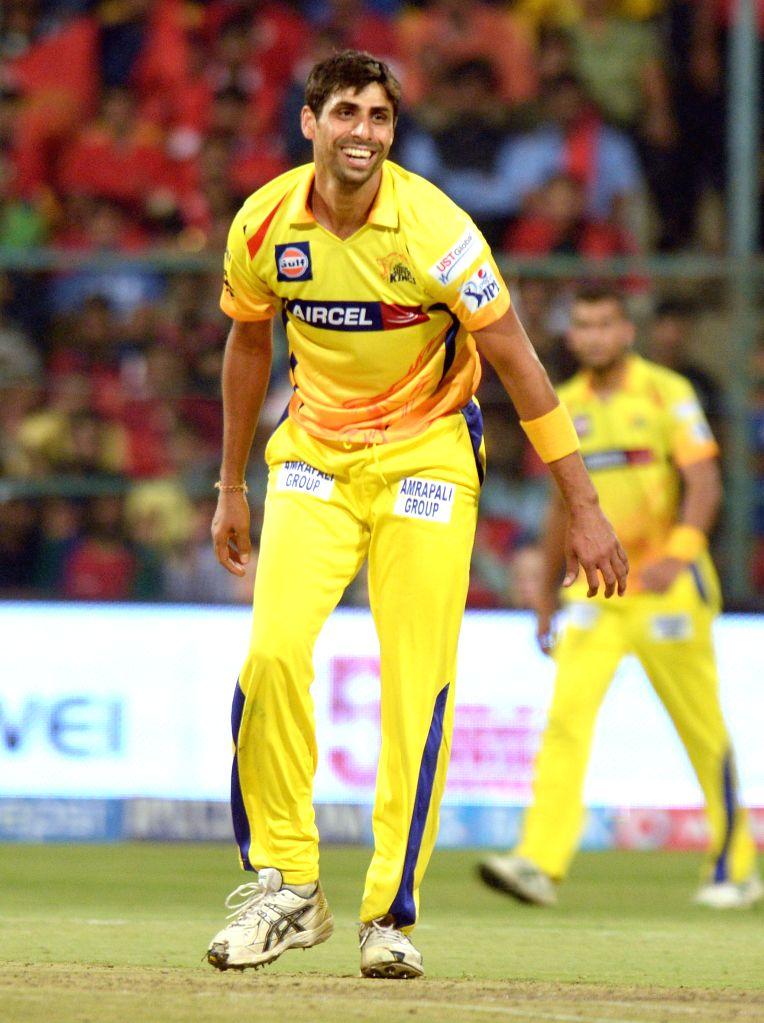 Chennai Super Kings bowler Ashish Nehra celebrates fall of a wicket during an IPL-2015 match between Royal Challengers Bangalore and Chennai Super Kings at M Chinnaswamy Stadium, in ... - Ashish Nehra