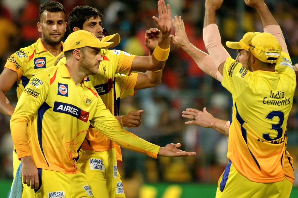 Chennai Super Kings celebrate fall of a wicket during an IPL-2015 match between Royal Challengers Bangalore and Chennai Super Kings at M Chinnaswamy Stadium, in Bengaluru, on April 22, ...