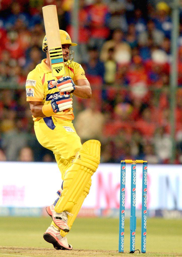Bengaluru : Chennai Super Kings player Suresh Raina in action during an IPL-2015 match between Royal Challengers Bangalore and Chennai Super Kings at M Chinnaswamy Stadium, in Bengaluru, on April 22, ...