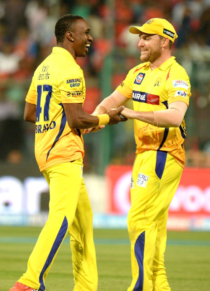Chennai Super Kings players  Dwayne Bravo and Brendon McCullum celebrate fall of a wicket during an IPL-2015 match between Royal Challengers Bangalore and Chennai Super Kings at M ...
