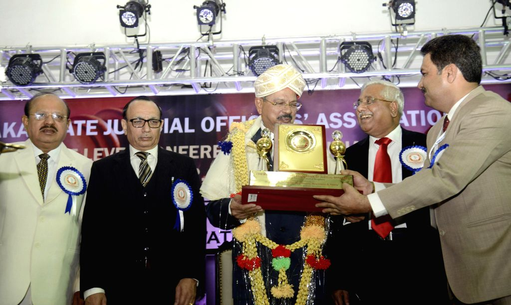 Chief Justice of India being H L Dattu being felicitated by Karnataka Chief Justice DH Waghela, Law Minister TB Jayachandra, Justice V Gopal Gowda and others during the 17th Biennial State