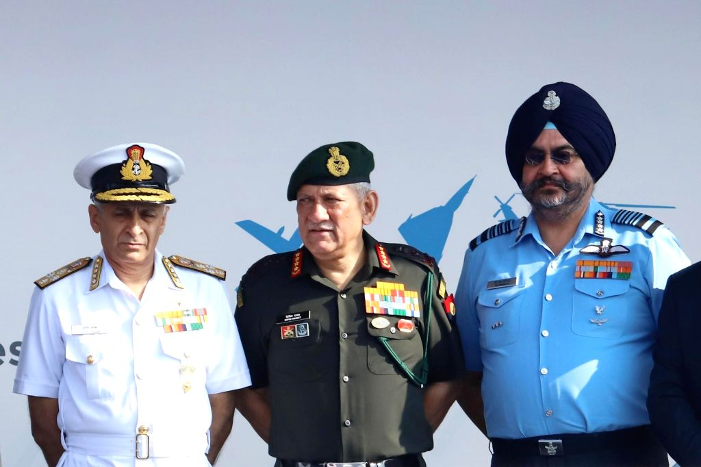 "Bengaluru: Chief of the Naval Staff, Admiral Sunil Lanba, Chief of the Air Staff, Air Chief Marshal B.S. Dhanoa and Army Chief Gen. Bipin Rawat  during the inauguration of the ""Aero India 2019"" - air show at Yelahanka Air Force Station, in Bengaluru,"