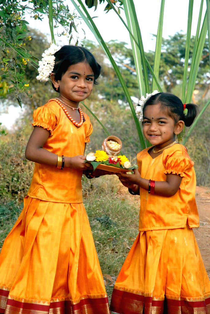 Children celebrate Sankranti with `Ellu-Bella` - sesame seeds- jiggery - in Bengaluru, on Jan 15, 2015.