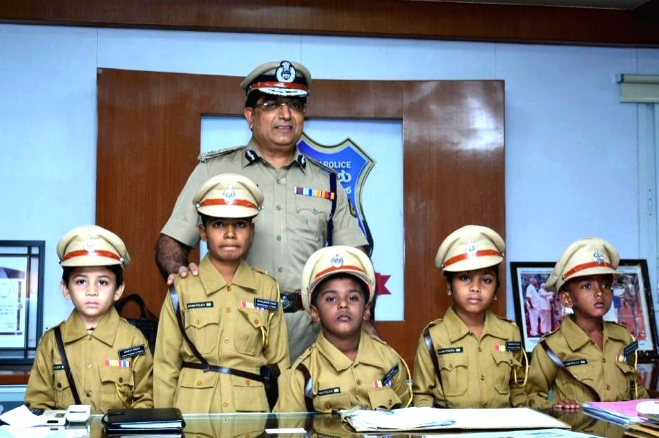 Bengaluru City Police Commissioner Bhaskar Rao with the five children suffering from life threatening diseases who were made Police Commissioners for a day under a joint initiative by ...