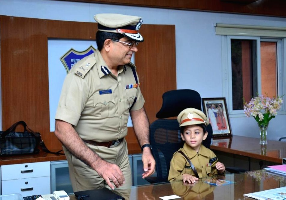 Bengaluru City Police Commissioner Bhaskar Rao with one of the five children suffering from life threatening diseases who were made Police Commissioners for a day under a joint initiative ...