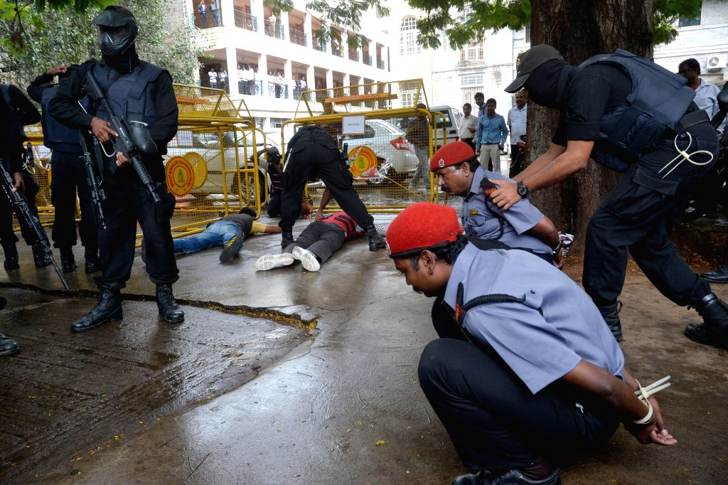 Commandos of Garud Commando Force - Karnataka State Police - participates in a mock drill to counter a hostage situation at BBMP Council Hall Complex in Bengaluru, on Nov 13, 2014.