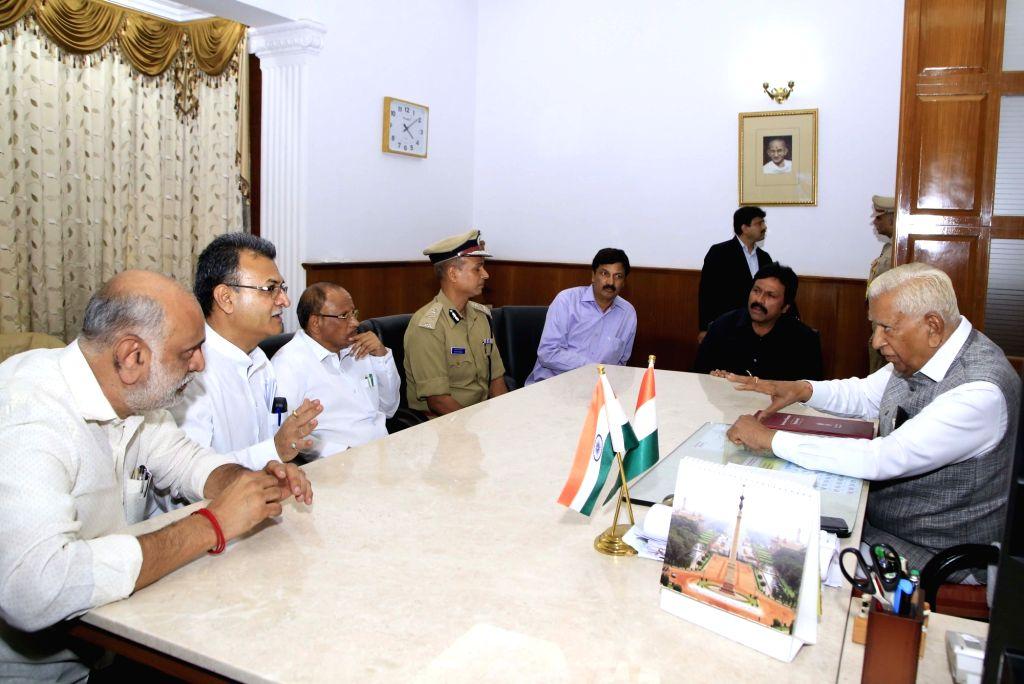Bengaluru: Congress and JD-S MLAs who submitted their resignations to the Karnataka Assembly Speaker, meet Governor Vajubhai Vala at Raj Bhawan in Bengaluru on July 6, 2019. (Photo: IANS)