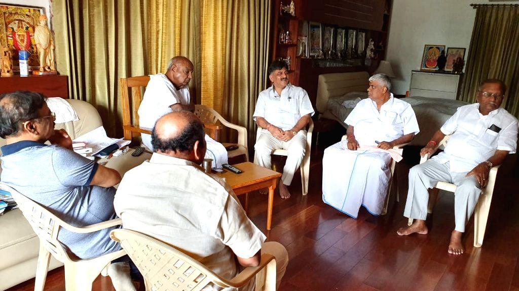 Bengaluru: Congress leader DK Shivakumar joined by JD-S leaders HD Revanna, D Kupendra Reddy, HK Kumaraswamy, and DC Thammanna meet JD-S chief HD Deve Gowda amid ongoing political turmoil in Karnataka; in Bengaluru, on July 7, 2019. (Photo: IANS) - D Kupendra Reddy