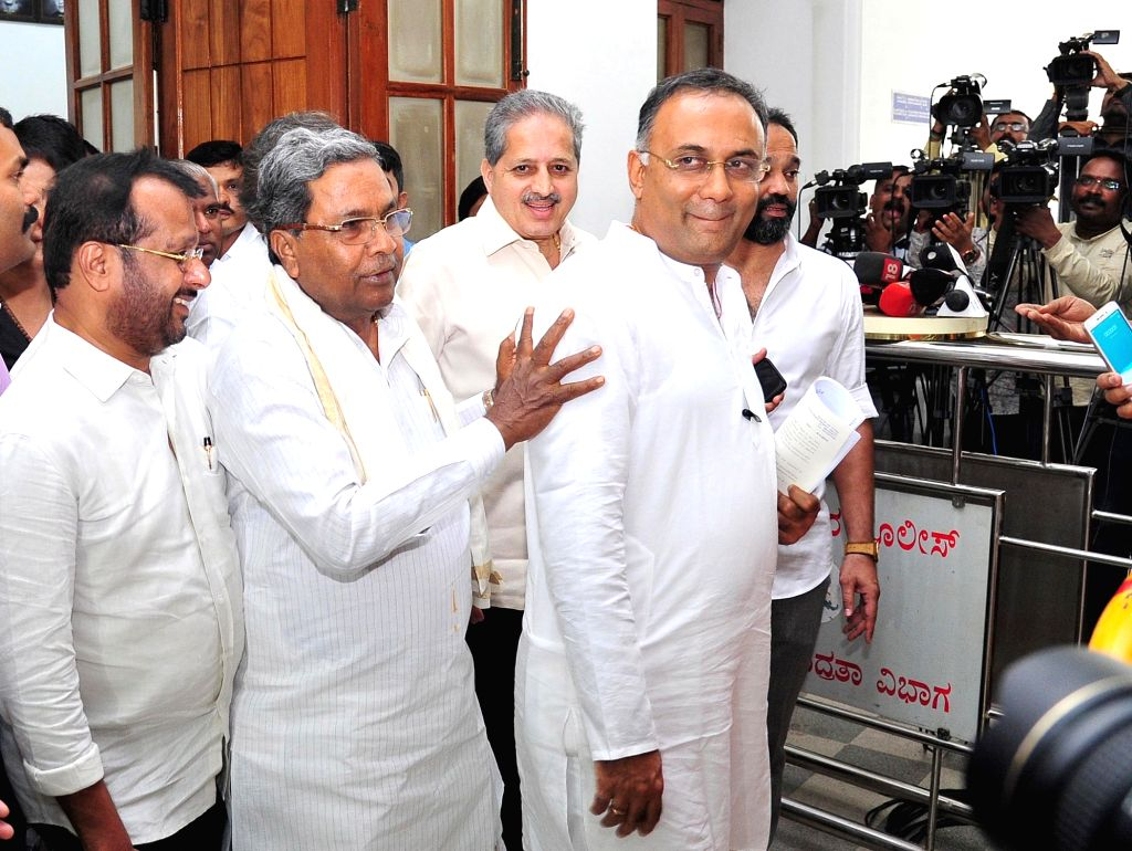 Bengaluru: Congress leaders Siddaramaiah and Dinesh Gundu Rao leave after the Congress Legislature Party (CLP) meeting at Vidhana Soudha in Bengaluru, on July 9, 2019. (Photo: IANS) - Dinesh Gundu Rao