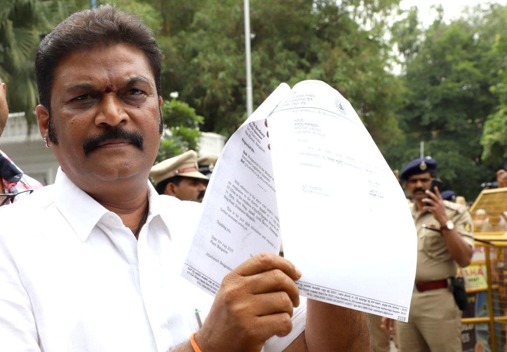 Bengaluru: Congress legislator Anand Singh talks to press in front Raj Bhavan in Bengaluru on July 1, 2019. He submitted his resignation to Karnataka Governor Vajubhai Vala. (Photo: IANS) - Anand Singh