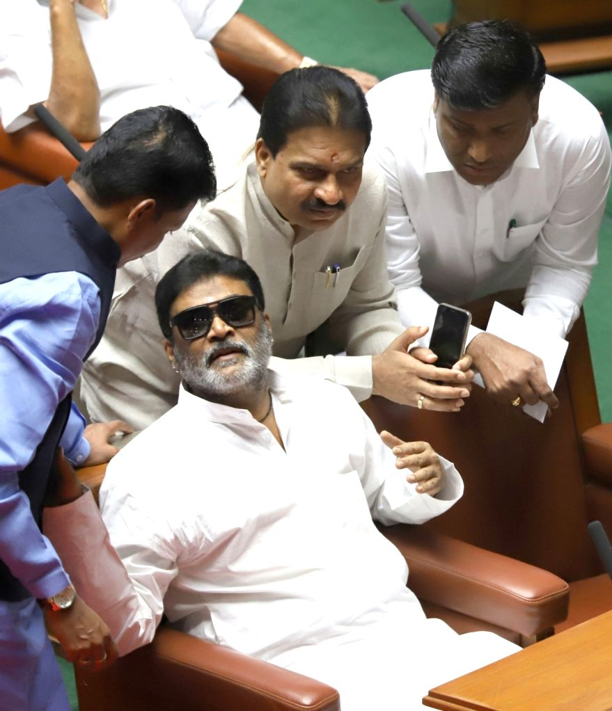 Bengaluru: Congress MLA Anand Singh in a conversation with other legislators of the party during the state assembly's Budget Session, in Bengaluru on Feb 6, 2019. (Photo: IANS) - Anand Singh