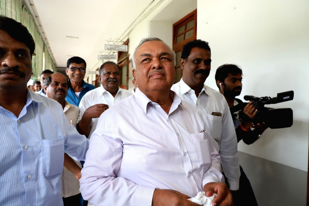 Bengaluru: Congress MLA Ramalinga Reddy leaves for Raj Bhawan to submit their resignations to Karnataka Governor, from the state assembly, in Bengaluru on July 6, 2019. (Photo: IANS) - Ramalinga Reddy