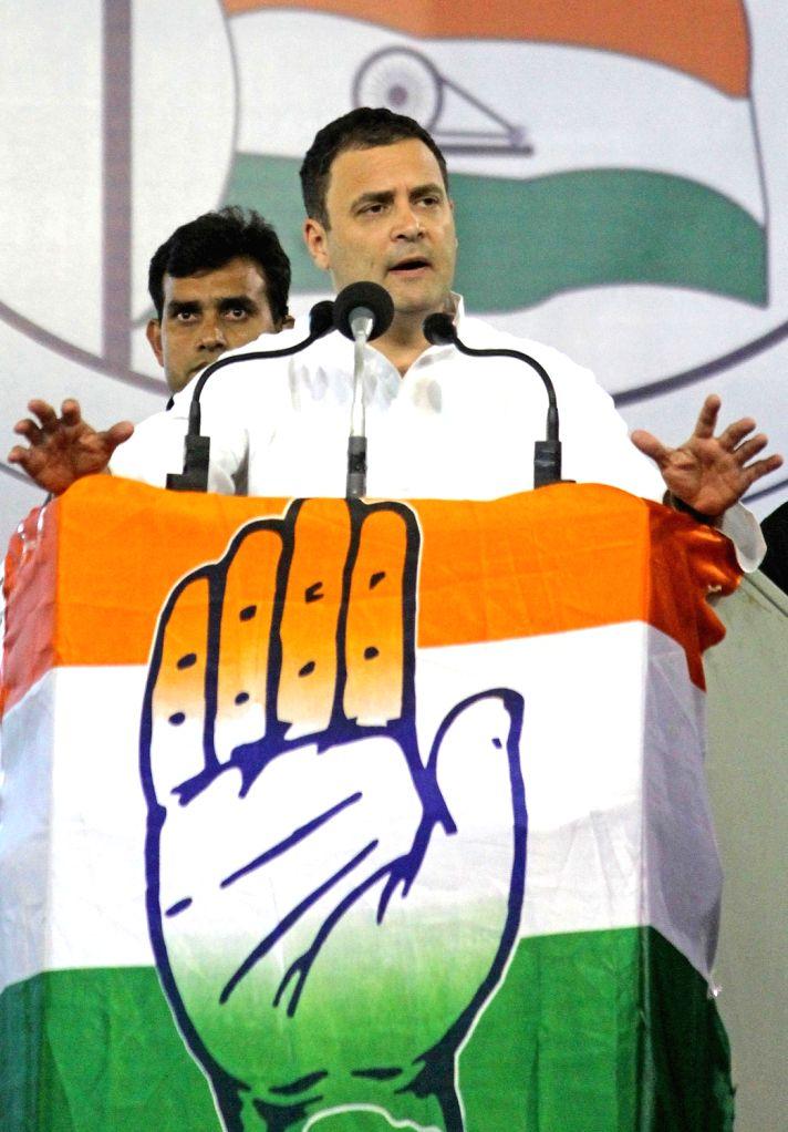 :Bengaluru: Congress President Rahul Gandhi addresses during a party rally at Palace Grounds, in Bengaluru on April 8, 2018. (Photo: IANS).