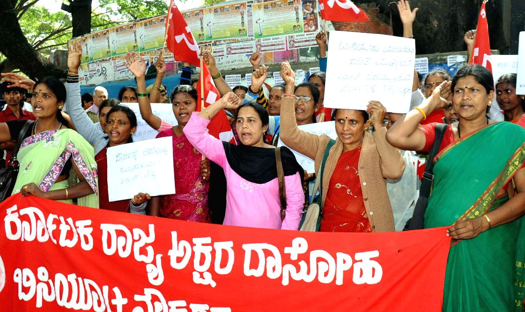 Dalit midday meal workers affiliated to CITU stage a protest against atrocities on dalit midday meal workers, in Benagluru on Dec 9, 2014.