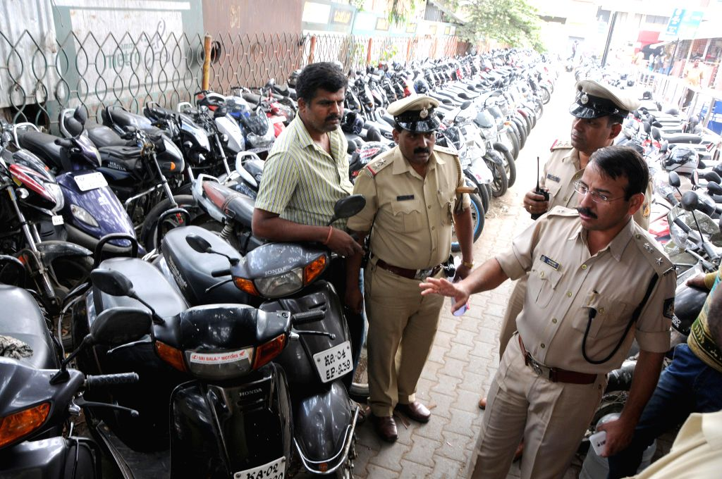 DCP Labu Rram visits KSRTC Bus Stand in the wake of Dec 28 Church street bomb blast, in Bengaluru, on Dec 29, 2014.