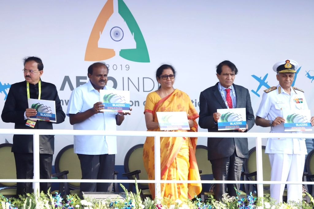 Bengaluru: Defence Minister Nirmala Sitharaman, Union Civil Aviation Minister Suresh Prabhu, Union MoS Defence Subhash Bhamre, Chief of the Naval Staff, Admiral Sunil Lanba and Karnataka Chief Minister H.D. Kumaraswamy during the inauguration of the  - Nirmala Sitharaman and Suresh Prabhu