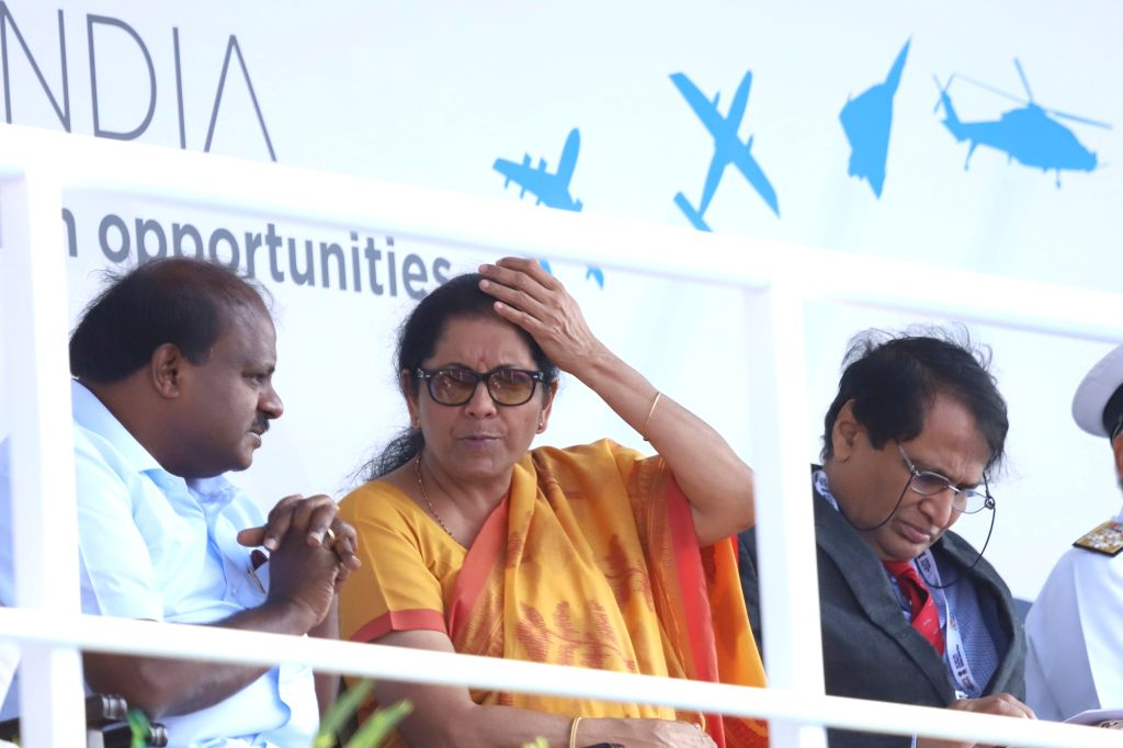 "Bengaluru: Defence Minister Nirmala Sitharaman, Union Civil Aviation Minister Suresh Prabhu and Karnataka Chief Minister H.D. Kumaraswamy during the inauguration of the ""Aero India 2019"" - air show at Yelahanka Air Force Station, in Bengaluru, on Feb - Nirmala Sitharaman and Suresh Prabhu"