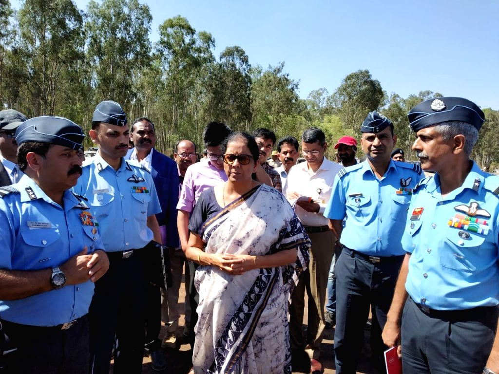 Bengaluru: Defence Minister Nirmala Sitharaman visits the site, where a fire broke out at the parking lot in front of Yelahanka Air Force Station gutting 300 cars, in Bengaluru, on Feb 24, 2019. (Photo: IANS) - Nirmala Sitharaman