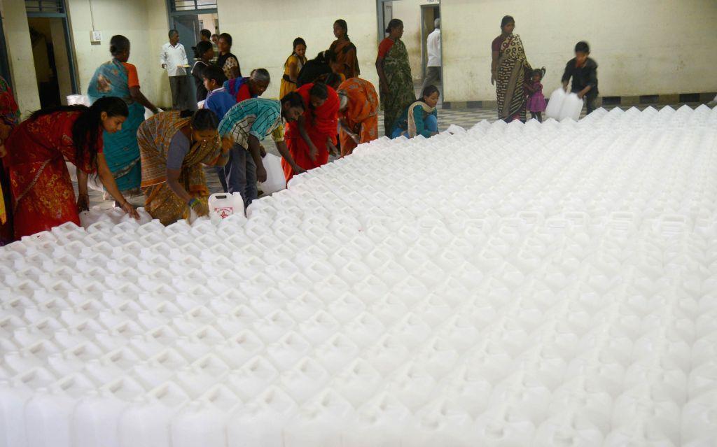 Devotees distribute Gangajal on the occasion of Mahashivaratri, at Rameshwara Swamy Temple in Bengaluru, on Feb 17, 2015. 40000 liters of Gangajal was distributed.