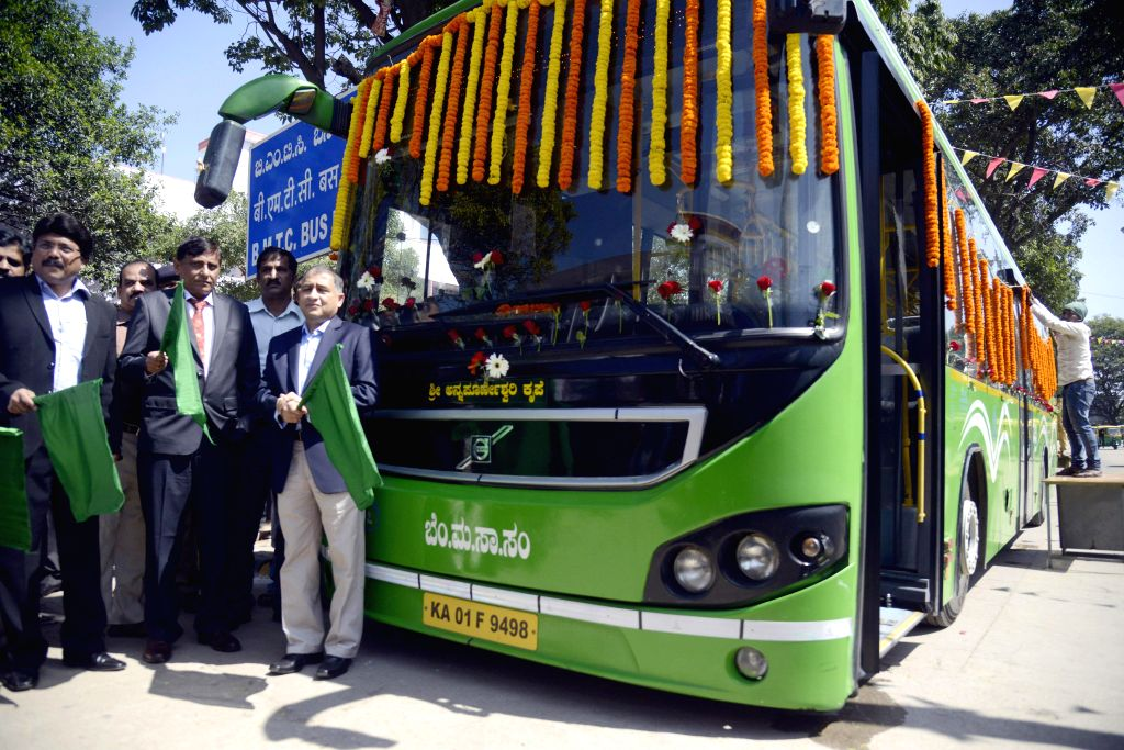 DRM Anil Kumar Agarwal with Senior DCM Dr Anup Dayanand flagging off the newly introduced BMTC Bus Service between Bangalore City Railway Station to KIAL Airport, at City Railway Station, . - Kumar Agarwal