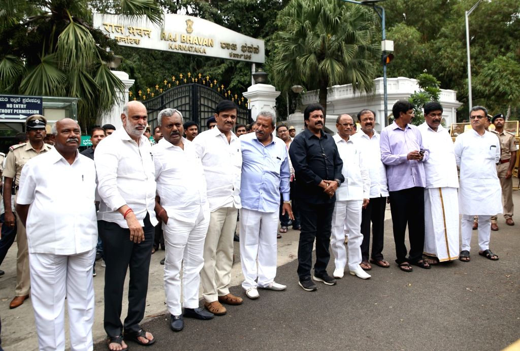 Bengaluru: Eight Congress and three Janata Dal-Secular (JD-S) legislators arrive at Raj Bhawan to submit their resignations to the Governor, in Bengaluru on July 6, 2019. (Photo: IANS)