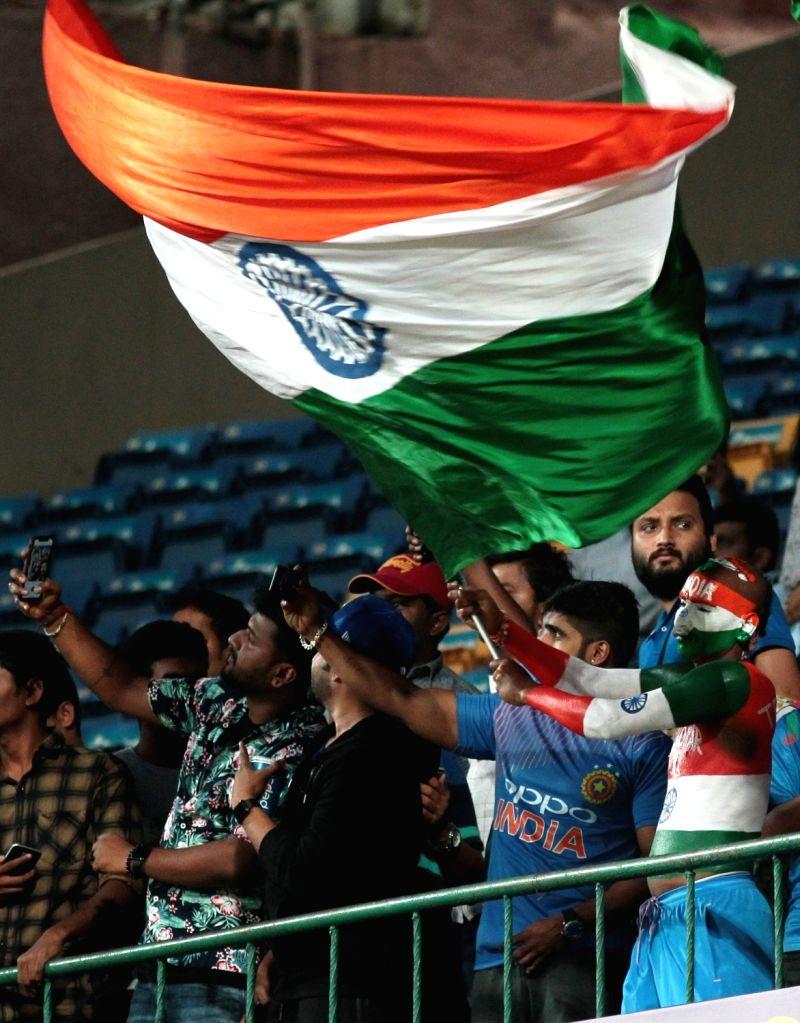 Bengaluru: Fans at M Chinnaswamy Stadium during the second T20I match between India and Australia in Bengaluru on Feb 27, 2019. (Photo: IANS)