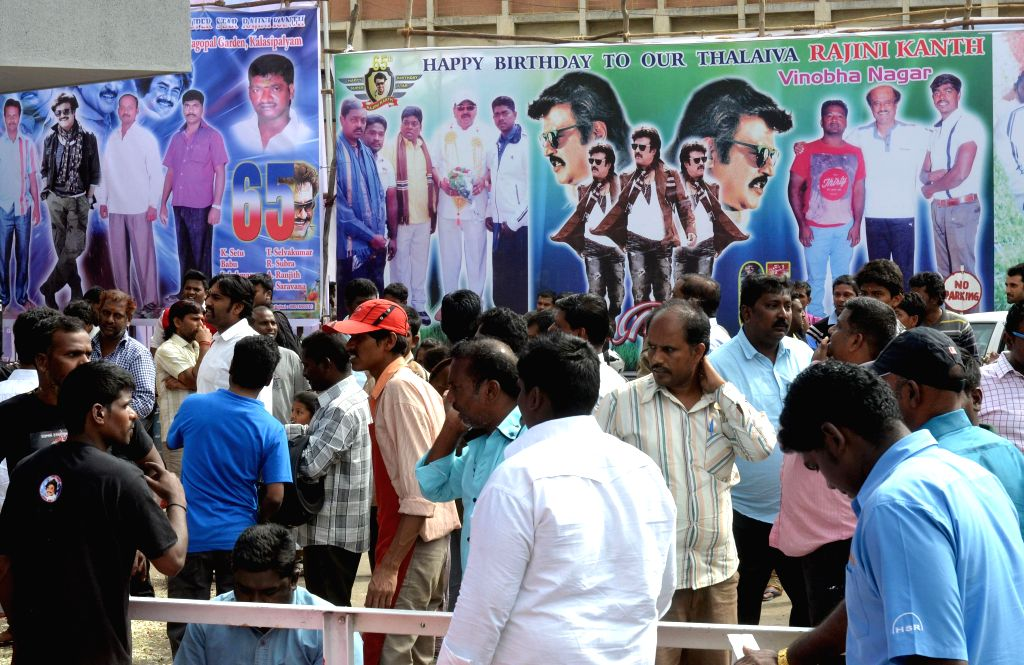 Fans of actor Rajanikant throng a cinema hall to watch his newly launched film `Lingaa` on his 65th birthday in Bengaluru on Dec 12, 2014. - Rajanikant