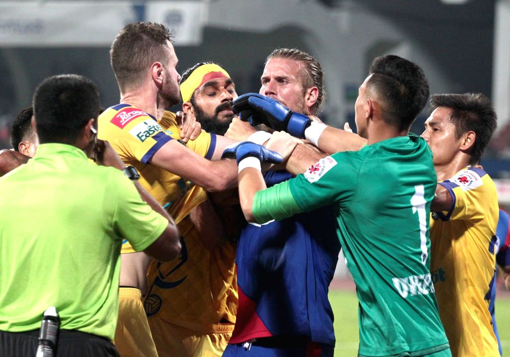 Bengaluru FC and Kerala Blasters FC players clash during an ISL 2018-19 match between BFC and Kerala Blasters FC at Kanteerava Stadium in Bengaluru on Feb 6, 2019.