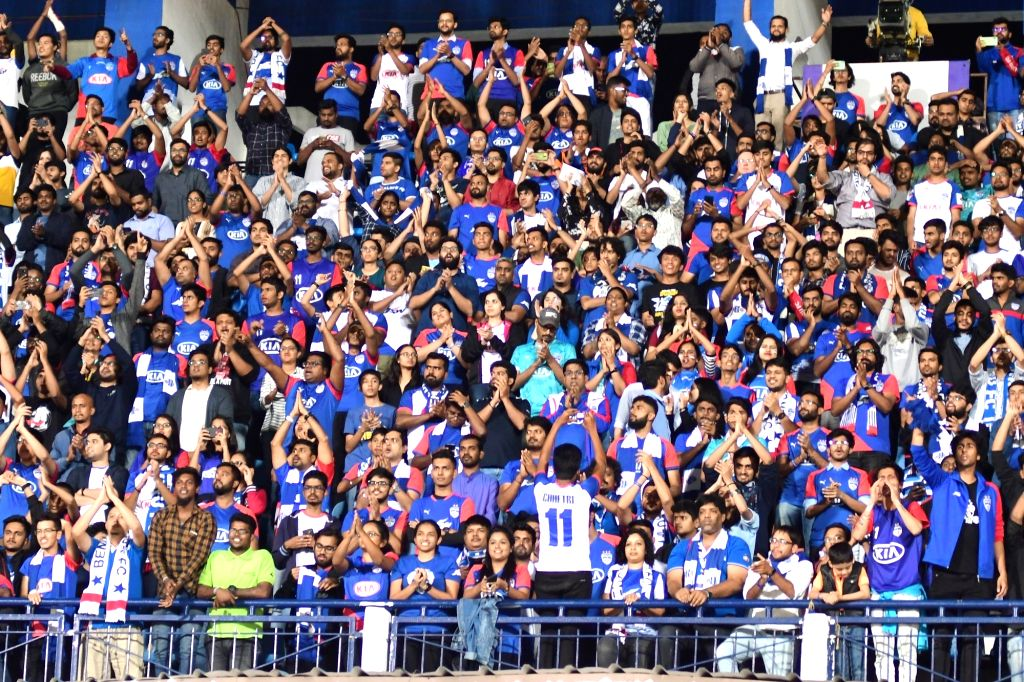 Bengaluru FC fans cheer for their team during an Indian Super League (ISL) 2019 match between Bengaluru FC and Jamshedpur FC at the Kanteerava Stadium in Bengaluru on Jan 9, 2020. ...