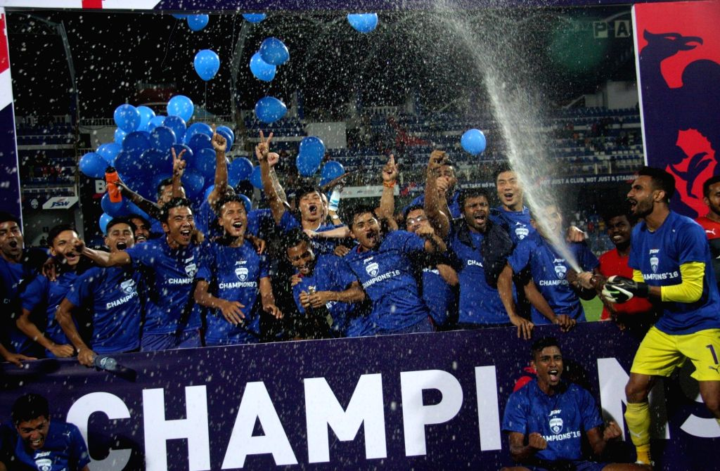 Bengaluru FC players celebrate after winning an I League match against Salgaocar Football Club in Bengaluru, on April 17, 2016.