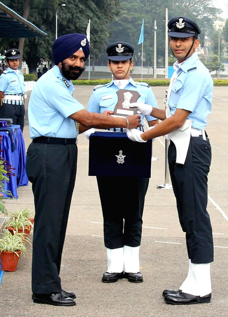 Flying Officer Kamalpreet Singh Maan receives President's Plaque for Best All Round Officer, during the Passing out parade at Air Force Technical College, in Bengaluru on Nov 28, 2014.