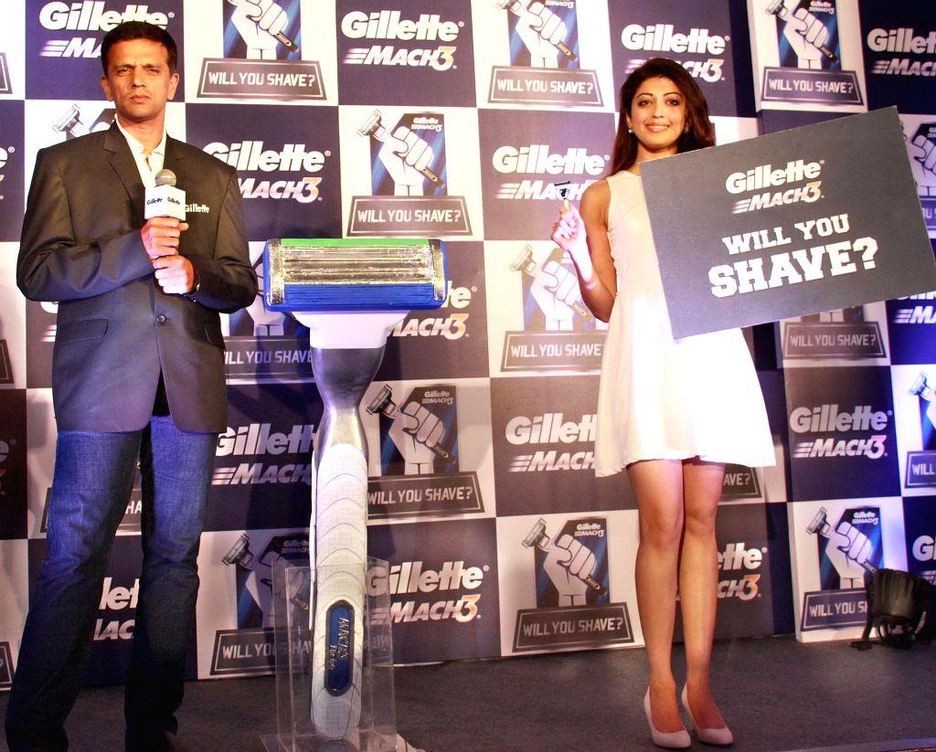 Former Indian cricketer Rahul Dravid with actress Pranitha Subhash during a programme in Bengaluru, on Nov 6, 2014.