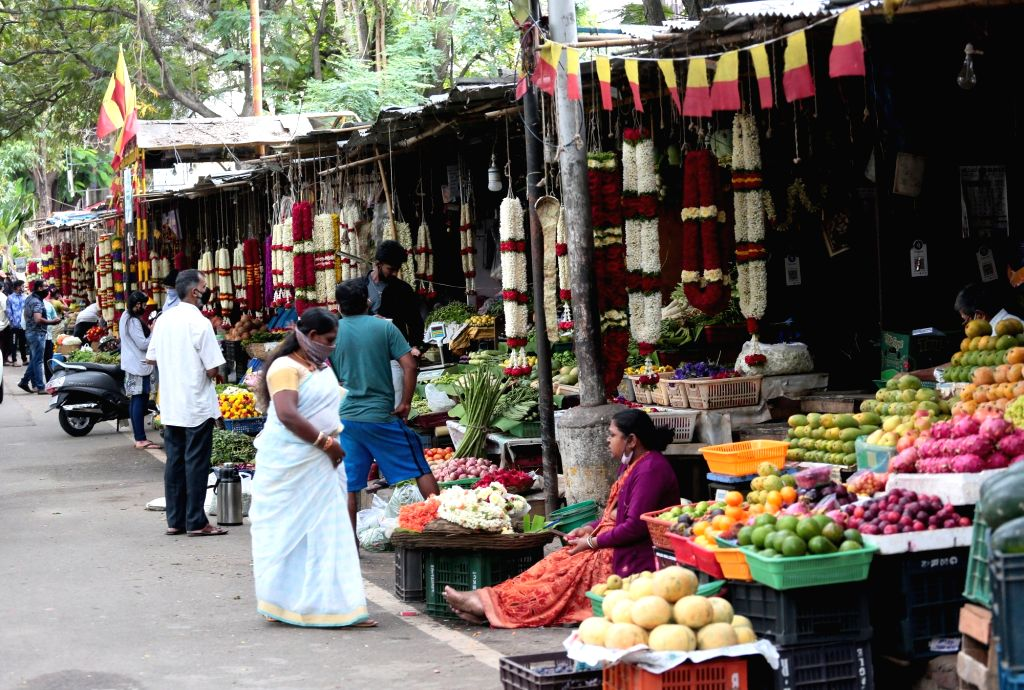 Bengaluru: Fruits and flower shops remain opened during a re-imposed lockdown across the city till July 22 for containing the corona virus spread, on July 15, 2020. (Photo: IANS)
