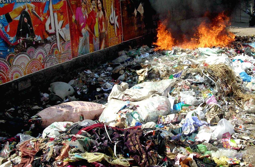 Garbage being disposed by burning at a garbage dump in Bengaluru, on Jan 4, 2015.