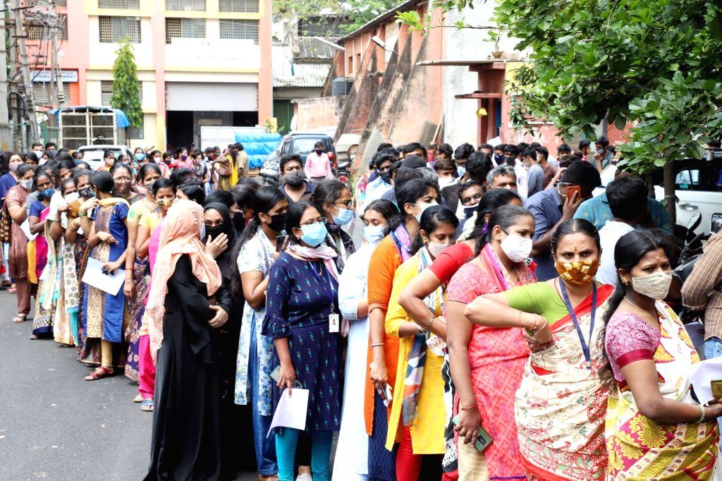 Bengaluru : Garment workers standing in a queue for vaccination at Industrial estate Rajajinagar, in Bengaluru on Thursday, June 24, 2021
