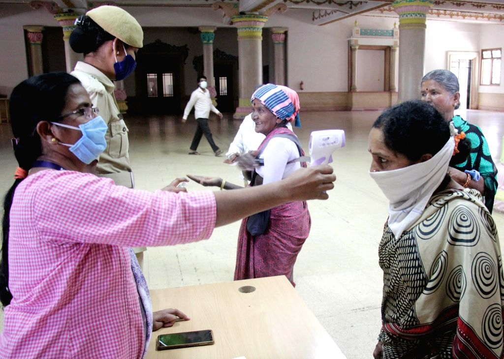 Bengaluru: Government staff undergoes thermal screening for COVID-19 at the Karnataka Secretariat Building, Multi-Storied Building (popularly known as MS Building ) in Bengaluru during the extended nationwide lockdown imposed to mitigate the spread o