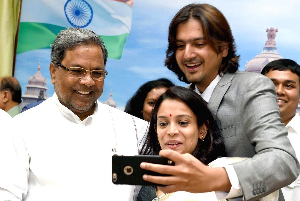 Grammy award winner Ricky Kej take`s a selfie with Karnataka Chief Minister Siddaramaiah at CM office in Bengaluru, on Feb 17, 2015. - Siddaramaiah