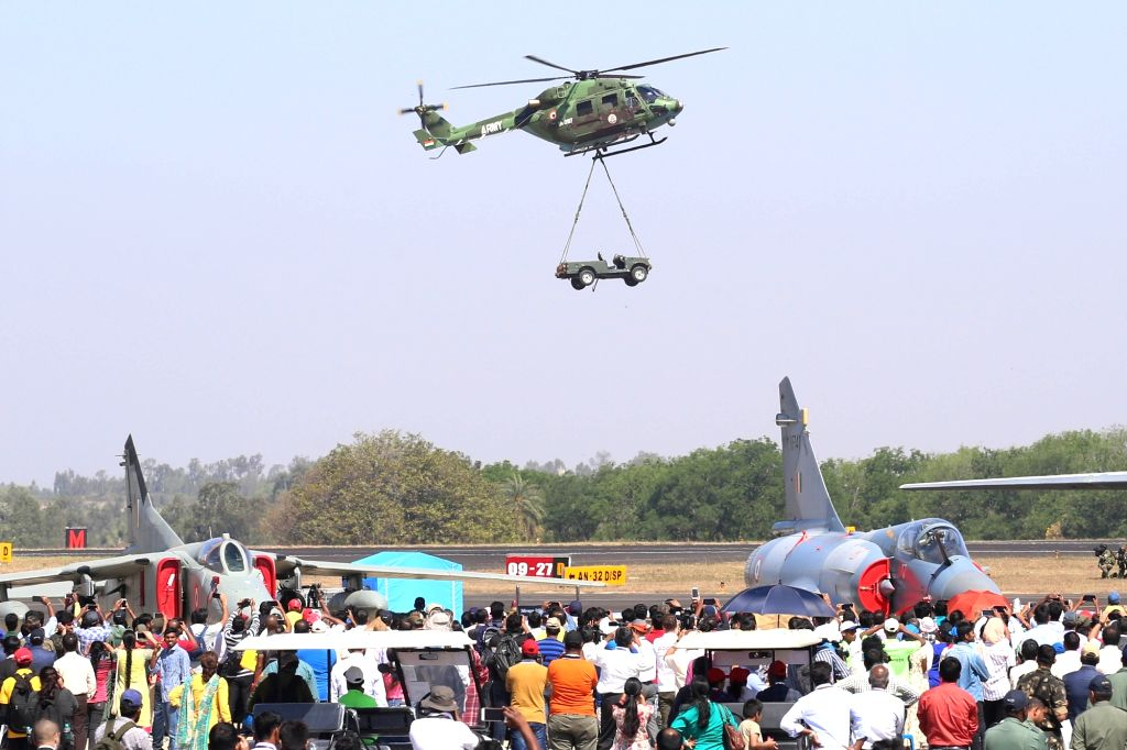 """Bengaluru: HAL Dhruv Advance Light Helicopter (ALH) during the """"Aero India 2019"""" - air show at Yelahanka Air Force Station, in Bengaluru, on Feb 22, 2019. (Photo: IANS)"""