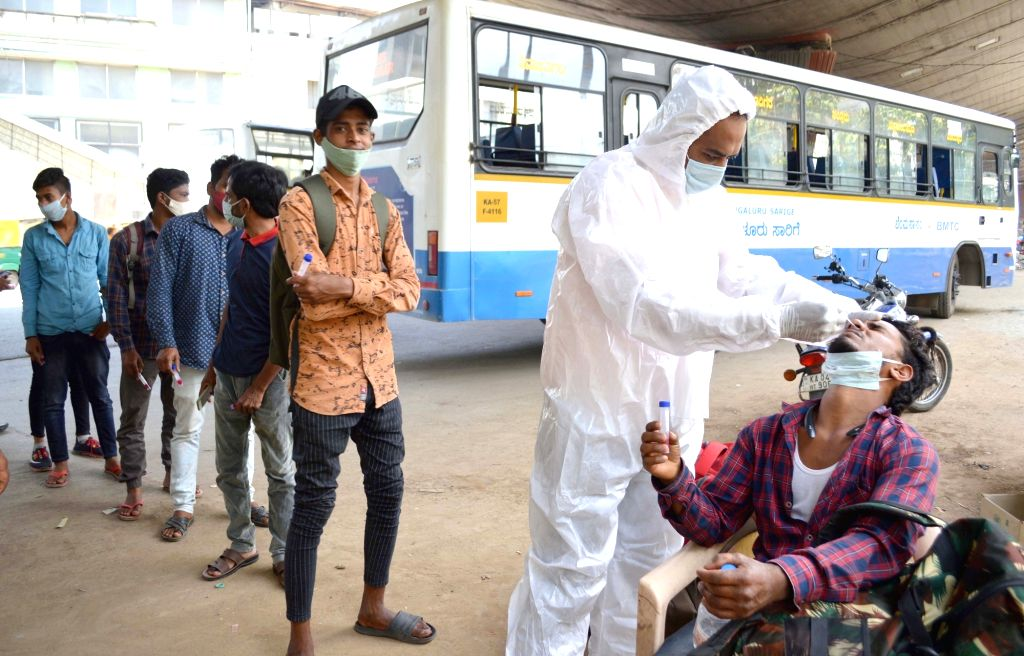 Bengaluru: Health workers conducting swab tests at KR Market after surge in new coronavirus cases, in Bengaluru on Thursday 25th March 2021. (Photo: IANS)